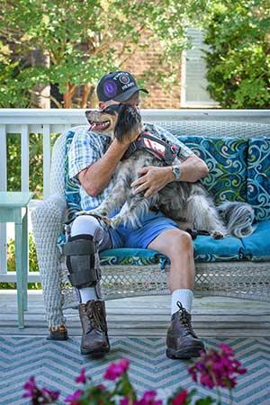 John Beahm shares a calming moment with his PTSD service dog, Sadie.